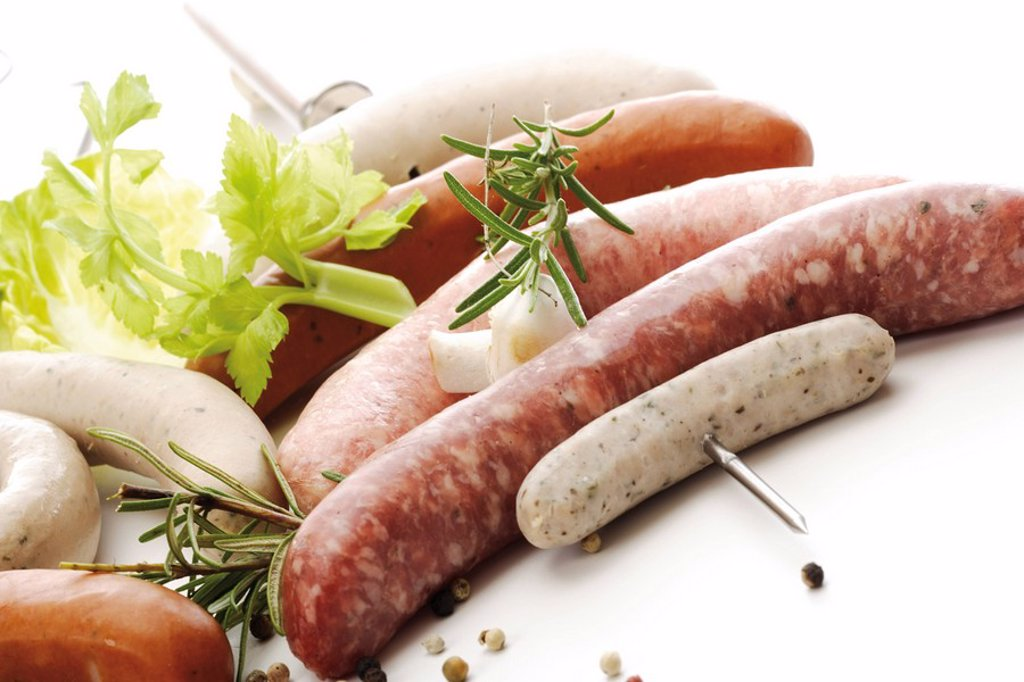 Skewered raw bratwursts, various kinds : Stock Photo