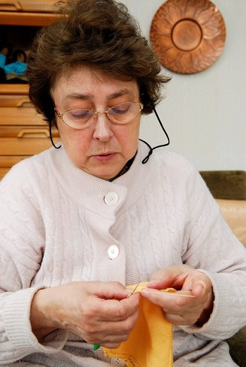 Woman crocheting : Stock Photo