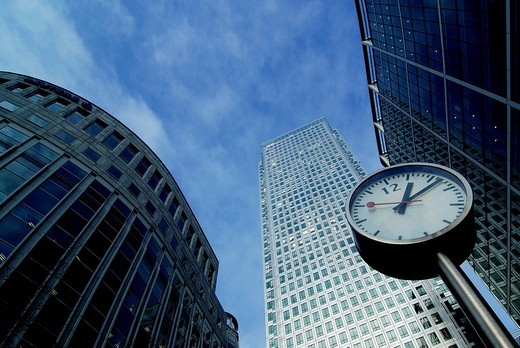 Clock in front of a high rise in London, England, Great Britain, Europe : Stock Photo