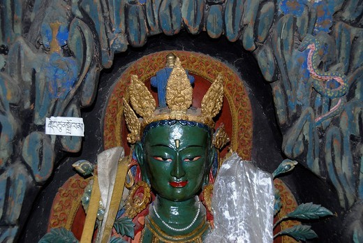 Stock Photo: 1848R-274177 Tibetan Buddhism old green painted figure Green Tara Bhrikuti Pelkor Choede Monastery Gyantse Tibet China
