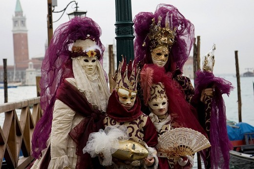 Stock Photo: 1848R-274487 Family, two adults and two children, wearing purple and gold costumes, Carnevale di Venezia, Carneval in Venice, Italy