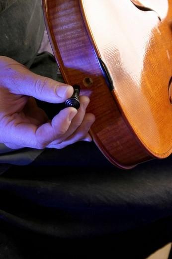 Stock Photo: 1848R-275526 Violin-maker luthier stringing a violin