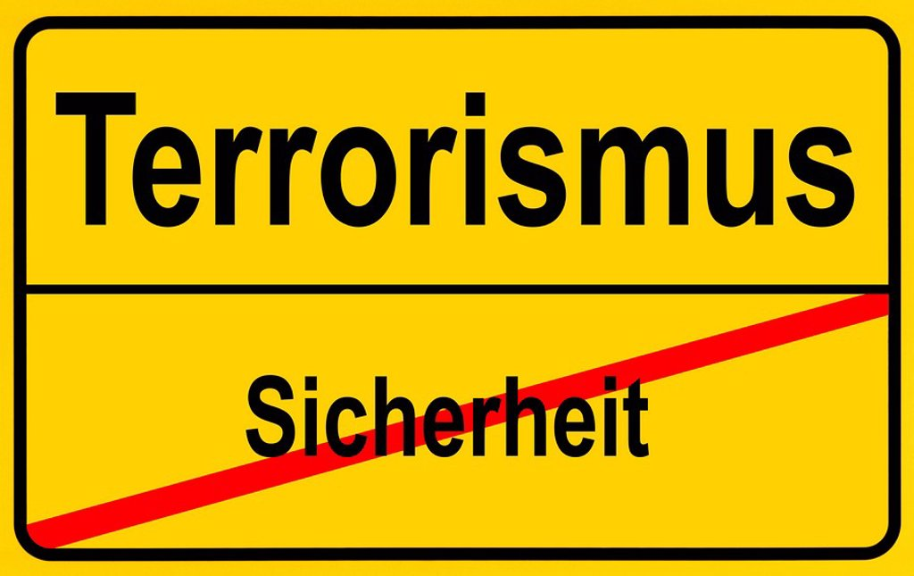Sign city limits, symbolic image for turning from security to terrorism : Stock Photo