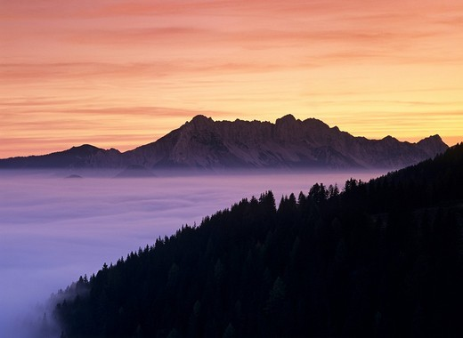 Stock Photo: 1848R-276391 Sunset and fog in the valley Steiner mountain range Carinthia Austria