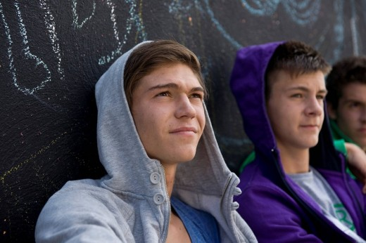 Stock Photo: 1848R-277030 Three boys leaning against a wall, cool