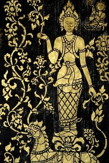Mythic being art detail of the decorated walls at temple Wat Xieng Thong Luang Prabang Laos : Stock Photo