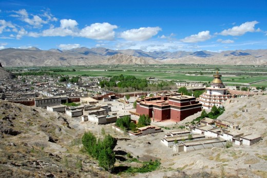 View of the Kumbum with the old town and green valley Dzong Pelkor Chöde Monastery Gyantse Tibet China : Stock Photo
