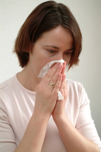 Woman with allergy hay fever : Stock Photo