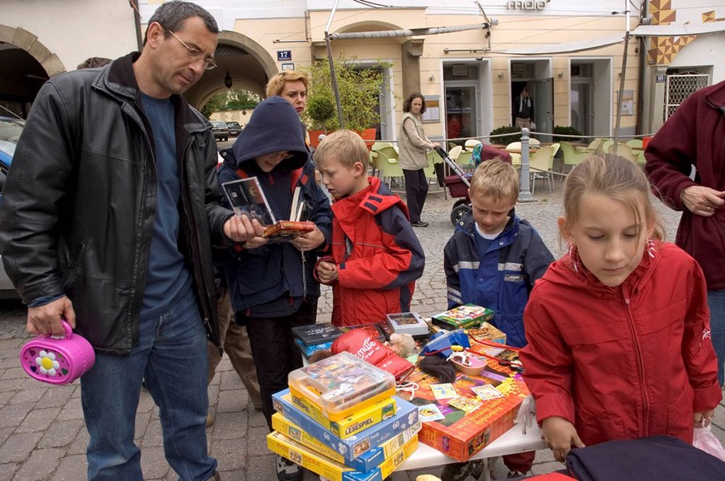 Stock Photo: 1848R-282810 Father with children at the toy flea market in Klosterneuburg near Vienna Austria