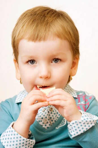 Stock Photo: 1848R-282965 Little girl, 3 years, eating waffle