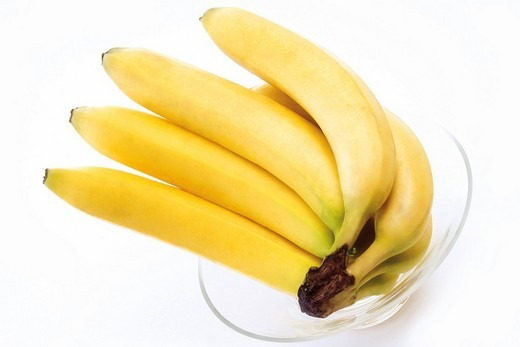 Stock Photo: 1848R-283803 Bunch of bananas in a glass bowl