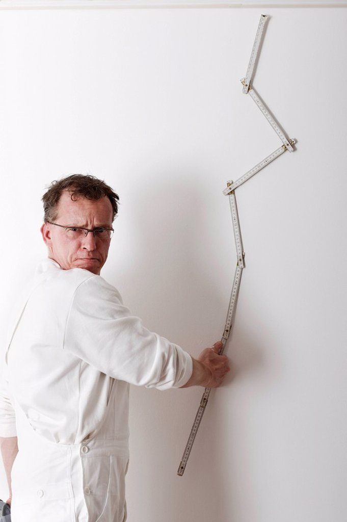 Stock Photo: 1848R-284048 Painter with a yardstick