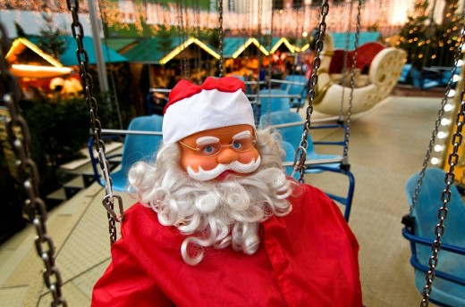 Father Christmas doll on a chairoplane, christmas market, Freiburg, Baden_Wuerttemberg, Germany : Stock Photo