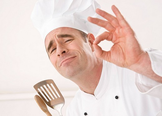 Cook gesticulating : Stock Photo