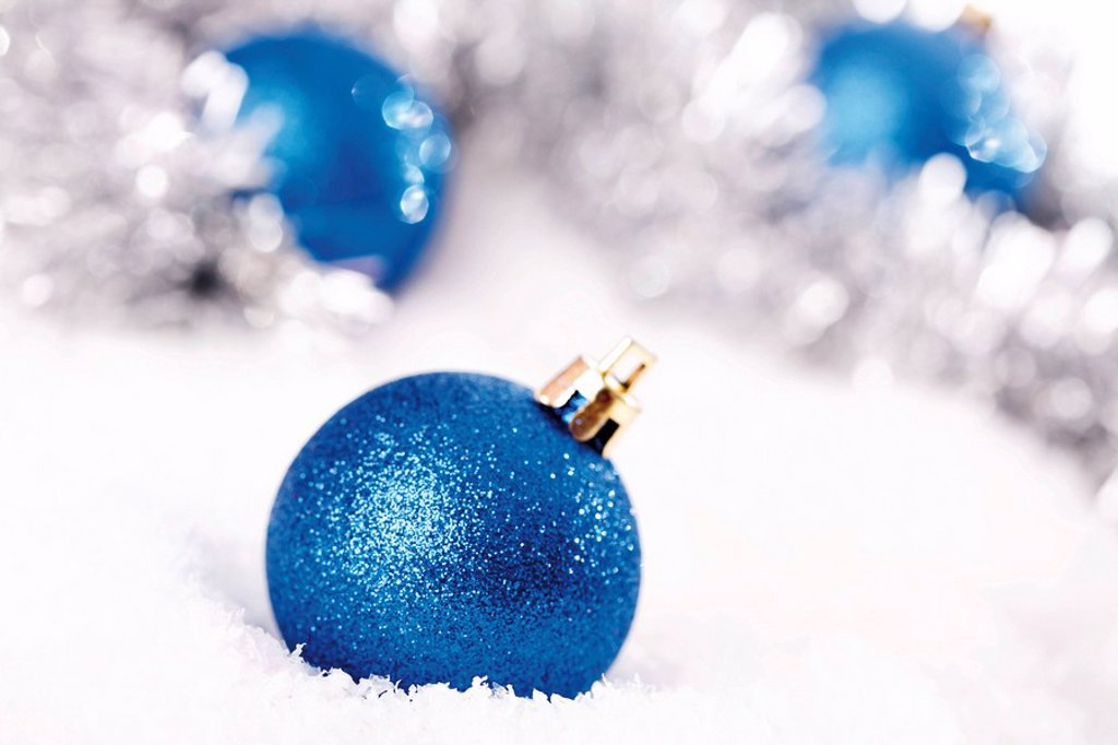 Stock Photo: 1848R-288182 Blue glitter Christmas tree balls on snow with Christmas decorations