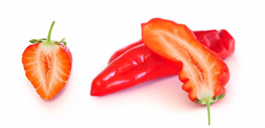 Stock Photo: 1848R-288389 Capsicum filled with Strawberry, symbolic image for genetic engineering