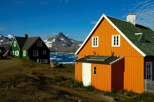 Colourful houses at a fjord in settlement Ammassalik Eastgreenland : Stock Photo