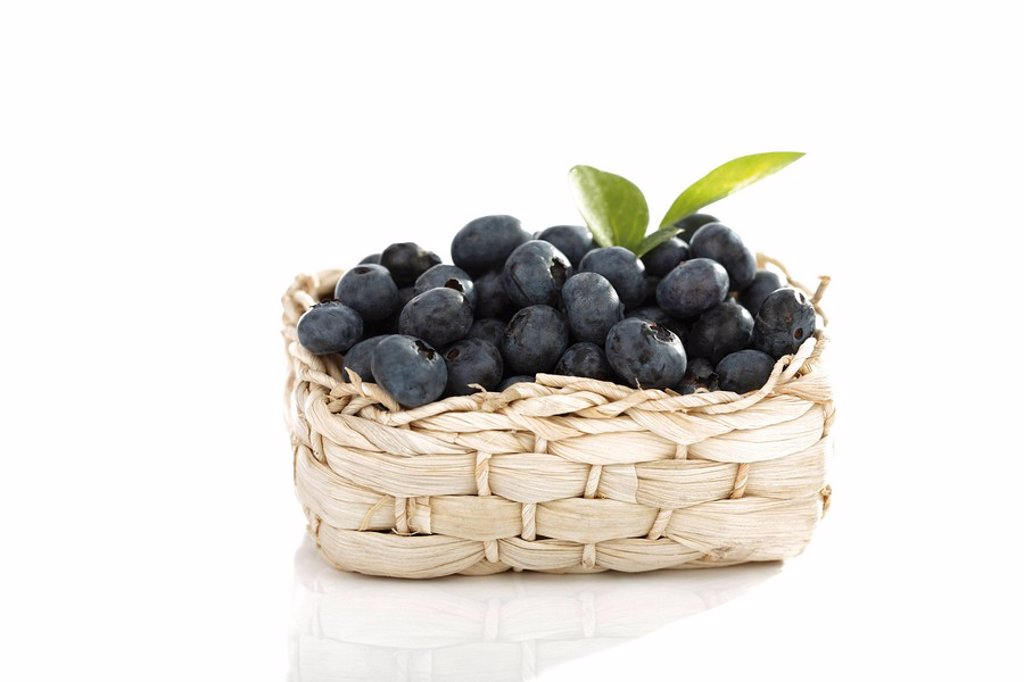 Blueberries in a bast basket : Stock Photo