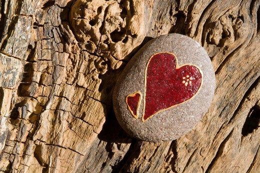 Red heart painted onto a stone : Stock Photo