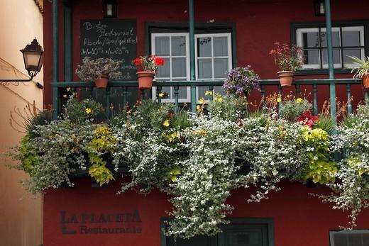 Balcony decorated with flowers, Avenida Marítima, Santa Cruz de la Palma, La Palma, Canary Islands, Spain : Stock Photo