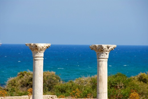 Two pillars of early Christian Basilica Kampanopetra at the sea seem to hold the sky archaeological site Salamis North Cyprus : Stock Photo