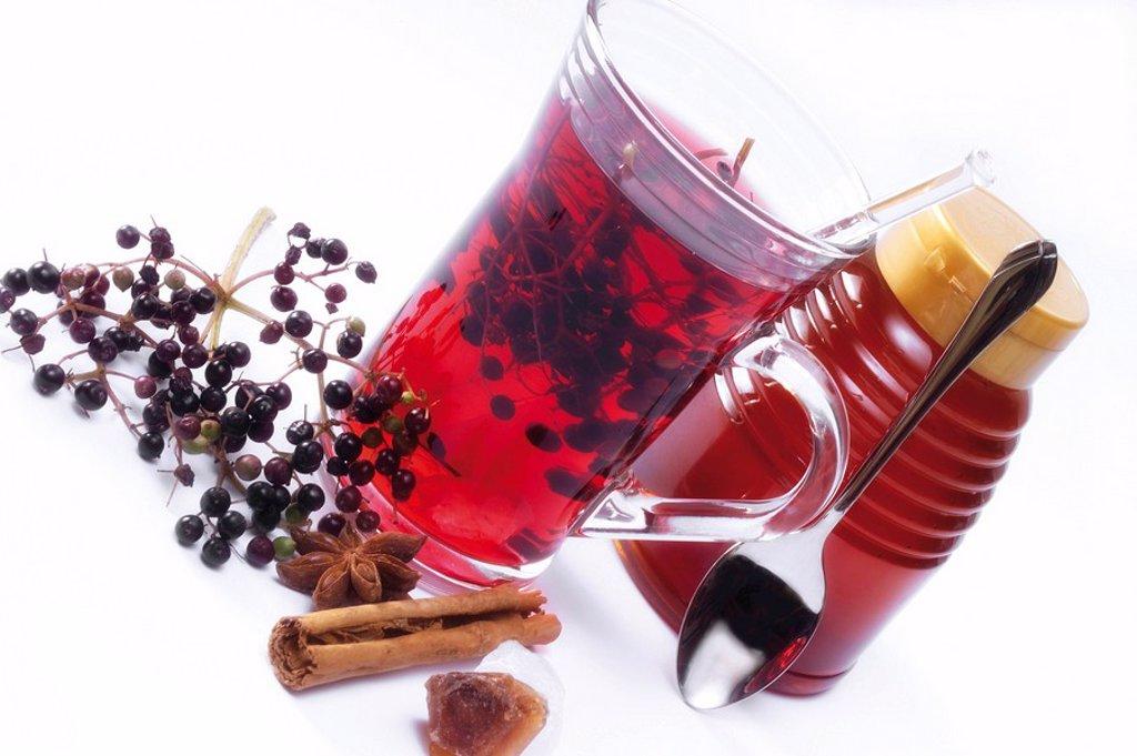 Stock Photo: 1848R-293090 Elderberry tea, cinnamon stick, honey and fresh elderberries