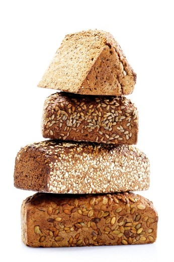 Four kinds of wholegrain bread, stacked : Stock Photo