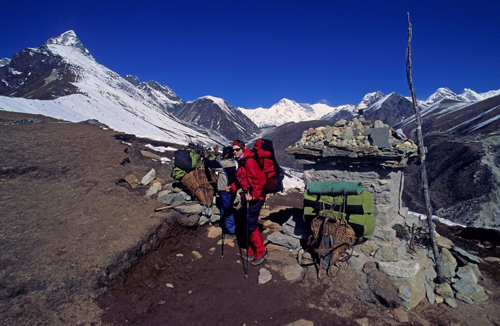 Stock Photo: 1848R-294207 Woman hiking on a pass near Machermo Nepal