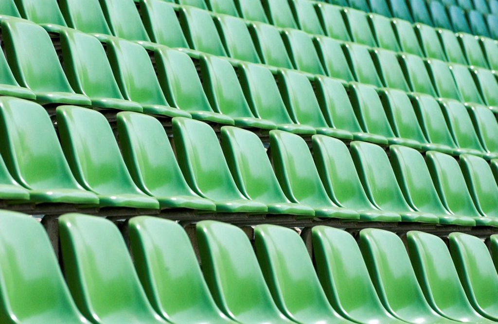 Empty plastic seats in sports stadium : Stock Photo