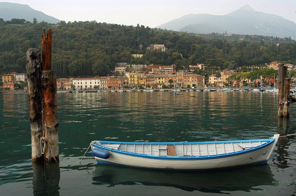 Moored rowboat on Lake Garda, Italy : Stock Photo