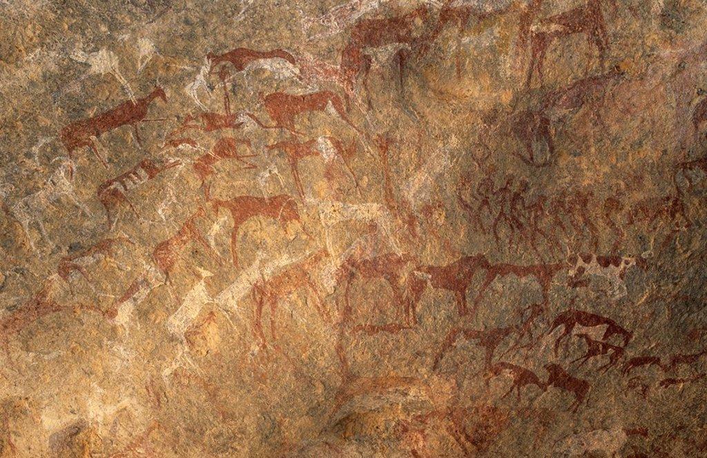 Prehistoric rock paintings at Jebel Uweinat, Jabal al Awaynat : Stock Photo