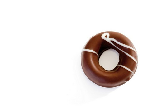 Stock Photo: 1848R-295540 Ginger candy ring coated in chocolate icing