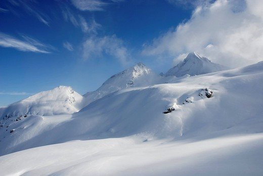 Foehn clouds over recently snowed up untouched winter landscape in the Zillertal alps Brandenberger Kolm Tyrol Austria : Stock Photo