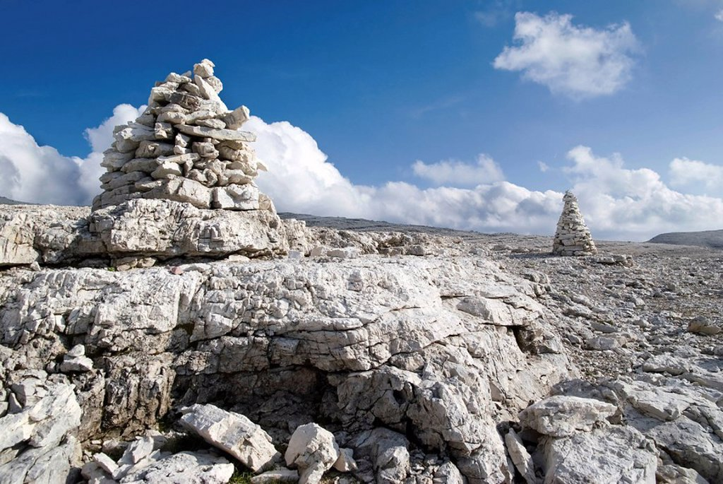 Stone markers, piles of stones, on the Sella massif, Passo Sella, province of Bolzano-Bozen, Italy, Europe : Stock Photo
