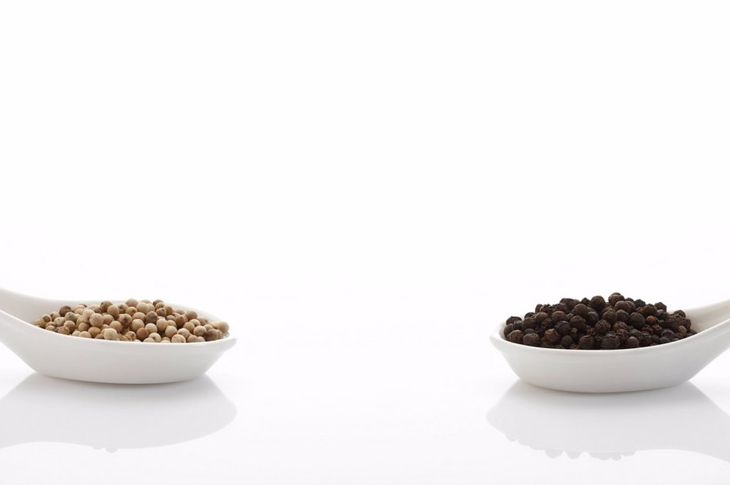 Peppercorn in porcelain spoons : Stock Photo