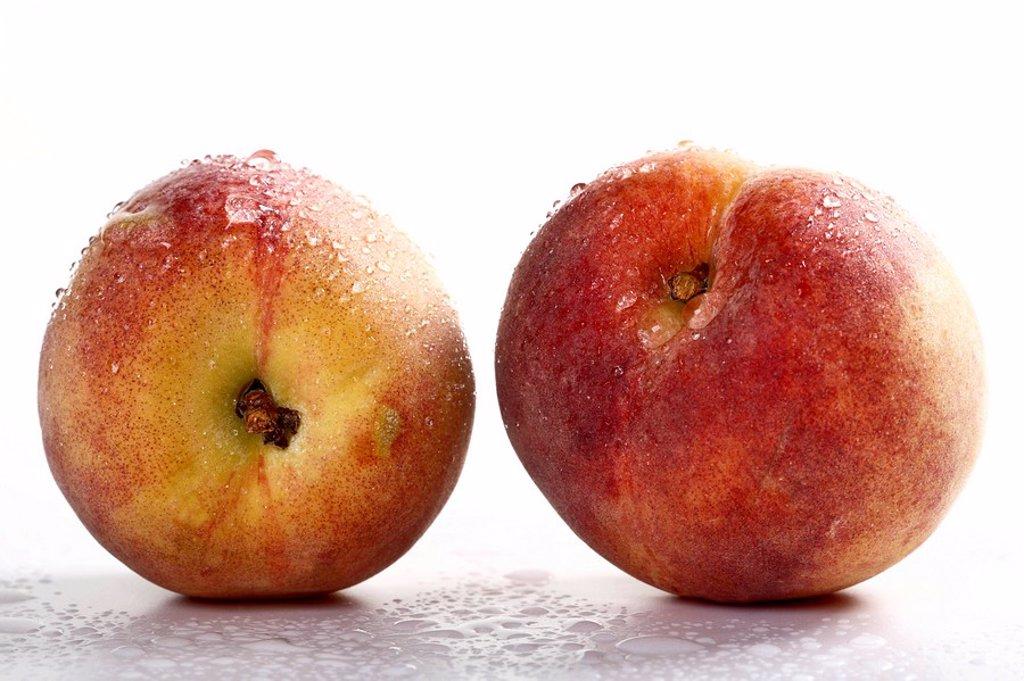 Stock Photo: 1848R-296850 Two Peaches