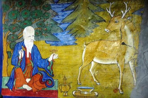 Wall painting of a meditating man and a deer in a temple Muktinath Mustang Annapurna Region Nepal : Stock Photo