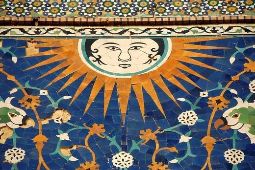 Face of the sun with rays as artful decorative maiolica on the portal of Nadir Divan-Begi Madrasah Bukhara Uzbekistan : Stock Photo