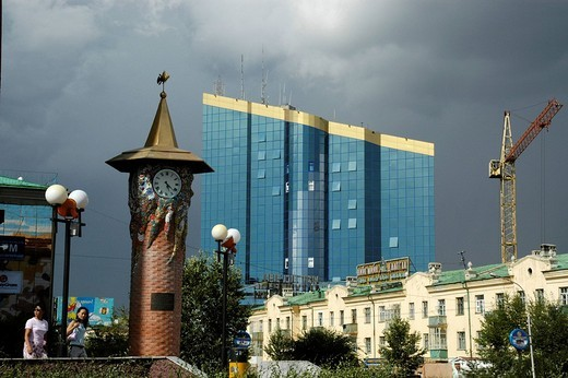 Stock Photo: 1848R-297186 City center with clock tower and a modern bureau sky scraper below a dark sky Ulaan Baatar Mongolia