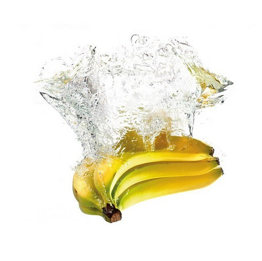 Bananas dropping into water : Stock Photo