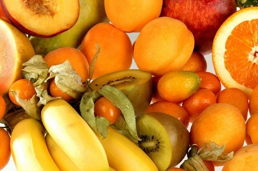 Assorted orange fruit on white background : Stock Photo
