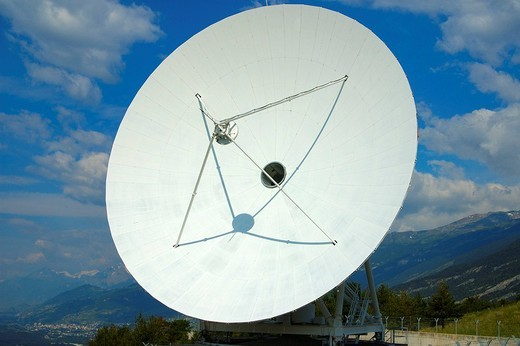 Cassegrain Parabolic antenna with subreflector Satellite Land Earth Station Leuk Valais Switzerland : Stock Photo