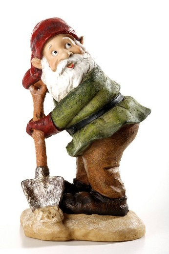 Stock Photo: 1848R-300653 Garden gnome holding shovel