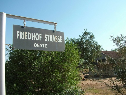 Stock Photo: 1848R-301161 Street sign in mixed German and Spanish language in front of a house of the pioneer´s time, Mennonite colony, Filadelfia, Fernheim, Gran Chaco, Paraguay