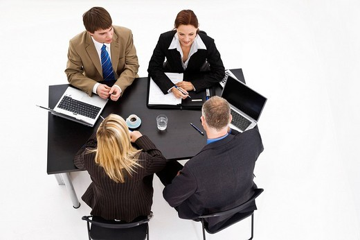 Business meeting, two women and two men, high_angle shot : Stock Photo