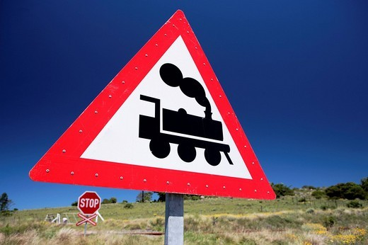Stock Photo: 1848R-302152 Train, railway crossing, sign, Grahamstown, Eastern Cape, South Africa