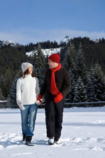 Man and woman going for a walk in the snow : Stock Photo