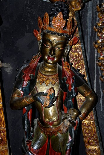 Stock Photo: 1848R-303371 Tibetan Buddhism old painted wooden figure Pelkor Choede Monastery Gyantse Tibet China