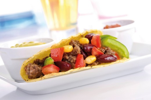 Stock Photo: 1848R-303964 Taco shell with chili con carne, guacamole and tomato salsa