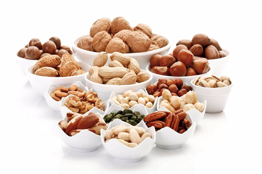 Stock Photo: 1848R-307023 Assorted nuts and kernels in ceramic bowls, pecans, walnuts, hazelnuts, macadamia nuts, peanuts, almonds, pistachios, and Brazil nuts